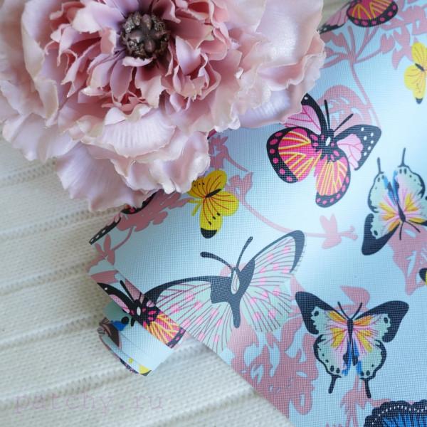 Кожзам разноцветные бабочки на голубом 19х140 см